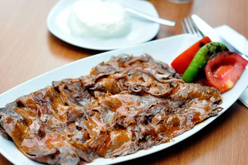 Turkish Cuisine - Iskender is Meat With Tomato Sauce on It Served With Yogurt