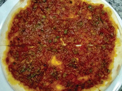 Budget Food UAE - Muhammara Manakish in Man'oushe Street Sells Authentic Dish With Red Peppers