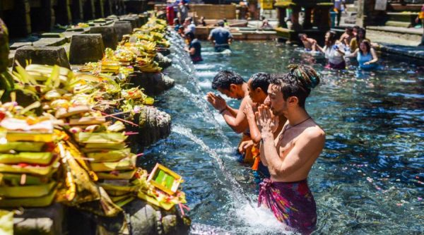 Indonesia Travel Tips - Tirta Empul Temple Has Water Coming Out of Carved Stone Pipes