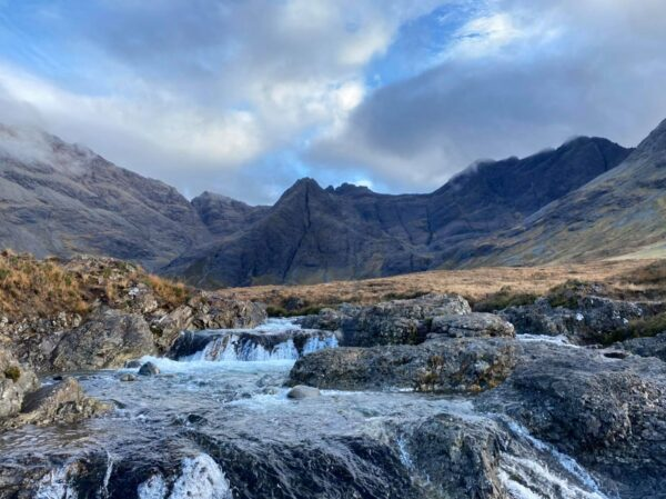 Unique Places to Visit For Tourists - Fairy Pools is located in Scotland in The Cuillin Hills