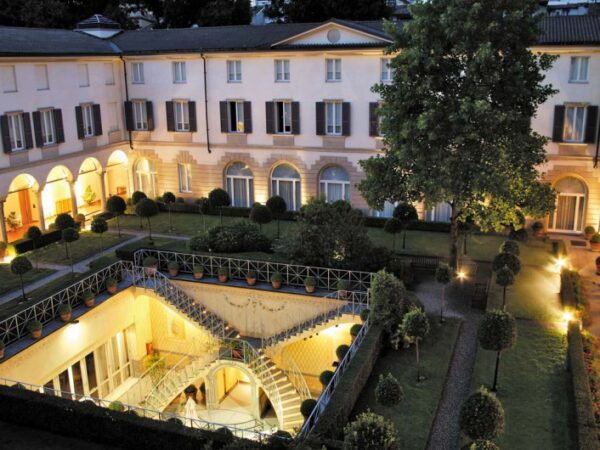 The Best Hotels in Milan - Four Seasons Hotel Milan With A Green Space For Eating Dinner