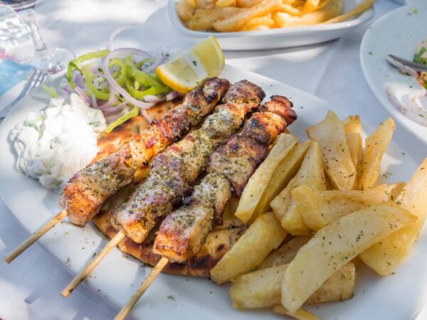 Most Delicious Greek Foods - Souvlaki A Chicken And Beef Dish With Pita Bread And Salad