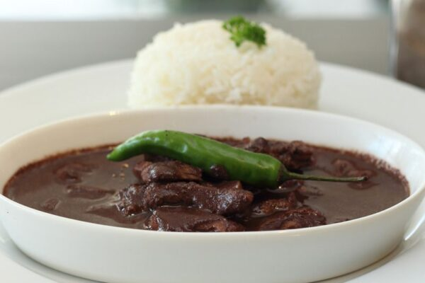 budget food Philippines - Dinuguan is Normally Served With Puto Rice On The Side