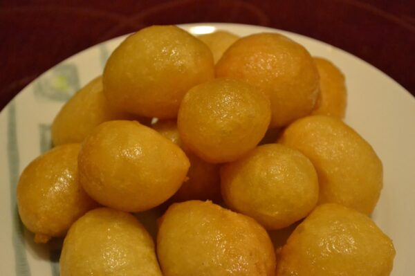 Travel Guide Cyprus - Loukoumades is A Glazed Honey Dessert Covered With Chopped Walnut