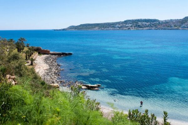 Best Beaches in Malta For Tourists - Mellieha Bay Has Small Economy Cafes