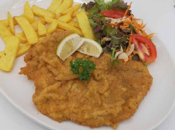 A Vienna Food Guide For Travelers - Schnitzel King is Near at Columbusplatz Tram Stop