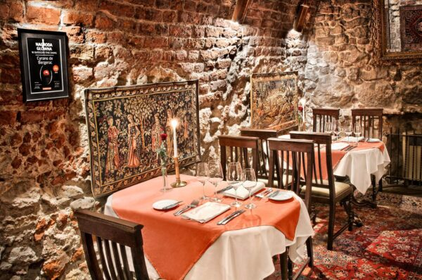 The Best Restaurants in Krakow - Cyrano de Bergerac is Decorated With Stone And Brick Walls
